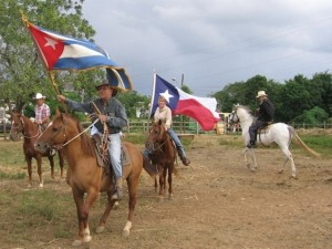 The-Cuban-and-Texas-flags-flying-together-during-a-pleasure-ride-outside-of-Havana.-This-event-minus-the-Texas-flag-made-page-3-of-the-NY-Times-on-November-12-2007.